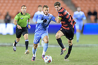 Houston, TX - Friday December 9, 2016: Zach Wright (10) of the North Carolina Tar Heels battles for the ball with Drew Skundrich (12) of the Stanford Cardinal at the NCAA Men's Soccer Semifinals at BBVA Compass Stadium in Houston Texas.