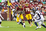 Landover, MD - August 24, 2018: Washington Redskins running back Adrian Peterson (26) runs the ball during the preseason game between Denver Broncos and Washington Redskins at FedEx Field in Landover, MD.   (Photo by Elliott Brown/Media Images International)