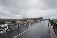 André Greipel (DEU/Lotto-Belisol) and his Lotto-Belisol leadout crossing the Po River<br /> <br /> 2014 Milano - San Remo