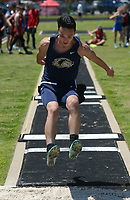 NWA Democrat-Gazette/ANDY SHUPE<br /> Miguel Silveria of Bentonville West leaps Wednesday, May 15, 2019, while competing in the long jump portion of the state decathlon championship at Ramay Junior High School. Visit nwadg.com/photos to see more photographs from the meet.