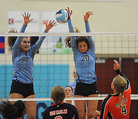NWA Democrat-Gazette/ANDY SHUPE<br /> Lindsay Glynn (4) of Rogers Heritage has her shot blocked by Lauren Thompson (20) and Emily Thompson (23) of Springdale Har-Ber Thursday, Sept. 17, 2015, at Wildcat Arena in Springdale. Visit nwadg.com/photos to see more photographs from the game.