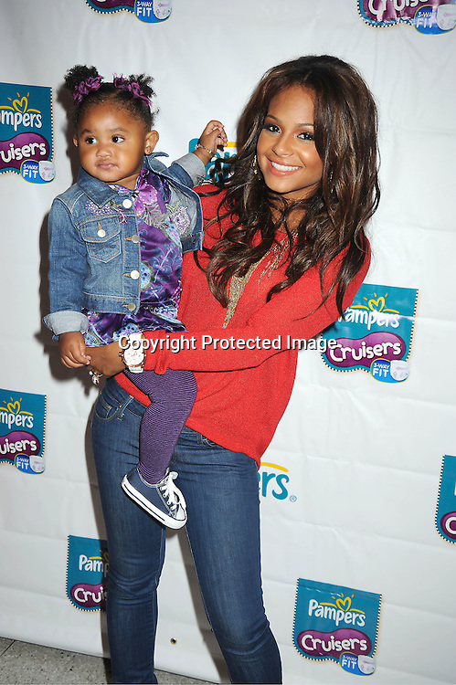 Christina Milian and daughter Violet attends the Pampers unveils improved cruisers diapers on .September 21, 2011 at Dylan's Candy Bar in New York City.