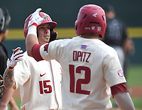 Arkansas' Casey Martin (15) is met at home plate by Casey Opitz after scoring a home run in the first inning against Grand Canyon University Wednesday March 11, 2020 at Baum-Walker Stadium in Fayetteville. Visit nwaonline.com/200312Daily/ for more images. (NWA Democrat-Gazette/J.T. Wampler)