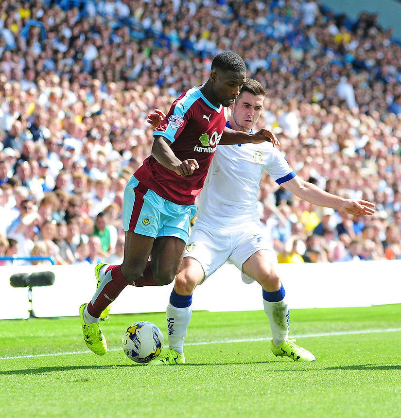 Burnley's Tendayi Darikwa vies for possession with Leeds United's Lewis Cook<br /> <br /> Photographer Chris Vaughan/CameraSport<br /> <br /> Football - The Football League Sky Bet Championship - Leeds United  v Burnley - Saturday 8th August 2015 - Elland Road - Beeston - Leeds<br /> <br /> &copy; CameraSport - 43 Linden Ave. Countesthorpe. Leicester. England. LE8 5PG - Tel: +44 (0) 116 277 4147 - admin@camerasport.com - www.camerasport.com