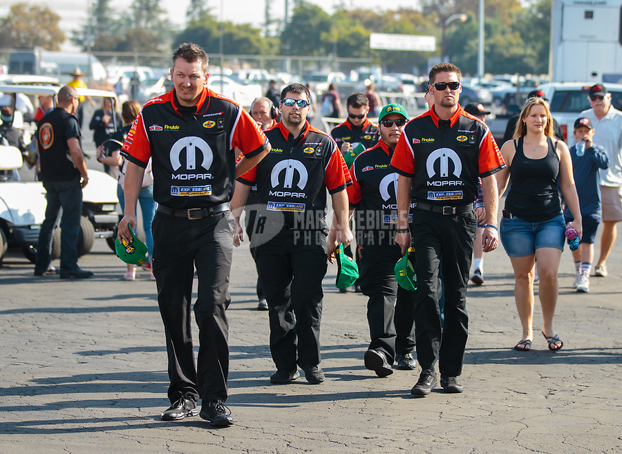 Nov 11, 2018; Pomona, CA, USA; Crew for NHRA top fuel driver Leah Pritchett during the Auto Club Finals at Auto Club Raceway. Mandatory Credit: Mark J. Rebilas-USA TODAY Sports