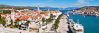 Panoramic photo of Trogir Old Town, Trogir, Dalmatian Coast, Croatia, Europe. This panoramic photo of Trogir Old Town showing the main road along the water front in Trogir, Obala Bana Berislavica, was taken from Kamerlengo Fortress (Gradina Kamerlengo). From right to left, the three main Cathedral bell towers that are visible are; Church and Monastery of St Dominic, Cathedral of St Lawrence and St Michael Monastery Church Bellfry. Trogir is a beautiful old town on the Dalmatian Coast of Croatia and is on the UNESCO World Heritage List thanks to it's stunning Romanesque Cathedral's and architecture. Inside the walls of the old town Trogir, the cobbled streets are complemented by beautiful buildings and towering spires. After visiting the many sites, there is always the option of a walk along Obala Bana Berislavica, the main street along the waterfront in Trogir that runs alongside the bright blue Adriatic Sea of the Dalmation Coast of Croatia.