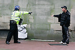 A member of the public argues with a police officer as Dudley town centre is cleared of protesters.