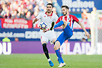 Saul Niguez Esclapez (r) of Atletico de Madrid battles for the ball with Vicente Iborra de la Fuente of Sevilla FC during their La Liga match between Atletico de Madrid and Sevilla FC at the Estadio Vicente Calderon on 19 March 2017 in Madrid, Spain. Photo by Diego Gonzalez Souto / Power Sport Images