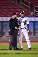 Umpire Mac Dietz  talks with Cedar Rapids Kernels manager Jake Mauer (12) during the second game of a doubleheader against the Kane County Cougars on May 10, 2016 at Perfect Game Field in Cedar Rapids, Iowa.  Cedar Rapids defeated Kane County 3-2.  (Mike Janes/Four Seam Images)