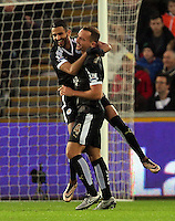 Riyad Mahrez of Leicester City (L) celebrates his opening goal with team mate Danny Drinkwater during the Barclays Premier League match between Swansea City and Leicester City at the Liberty Stadium, Swansea on December 05 2015