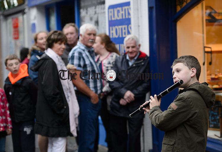 Neil Martin of Kilcolgan playing in the street at Fleadh Cheoil na hEireann in Ennis. Photograph by John Kelly.