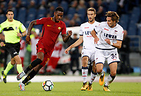 Calcio, Serie A: Roma vs Crotone. Roma, stadio Olimpico, 25 ottobre 2017.<br /> Roma's Gerson, left, is challenged by Crotone Andrea Barberis, center, and Stefan Simic, during the Italian Serie A football match between Roma and Crotone at Rome's Olympic stadium, 25 October 2017.<br /> UPDATE IMAGES PRESS/Riccardo De Luca