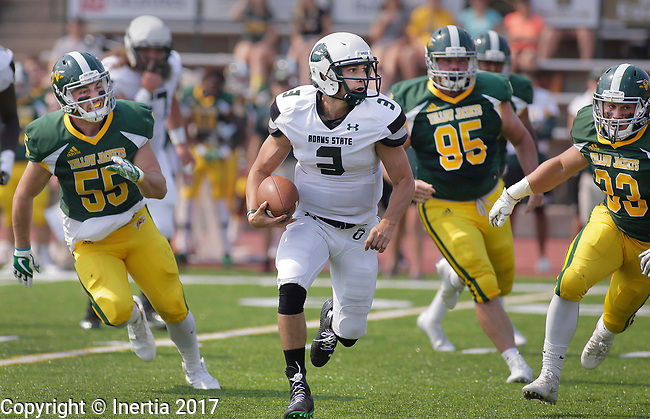 SPEARFISH, SD: SEPTEMBER 2: Adams State quarterback Jorge Hernandez #3 runs past Black Hills State defenders Kolten Johnson #55, Conor Heaney #95 and Austin Goddard #33 during their game Saturday at Lyle Hare Stadium in Spearfish, S.D.   (Photo by Dick Carlson/Inertia)