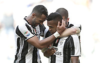 Calcio, Serie A: Juventus vs Crotone. Torino, Juventus Stadium, 21 maggio 2017.<br /> Juventus&rsquo; Alex Sandro, center, celebrates with teammates after scoring during the Italian Serie A football match between Juventus and Crotone at Turin's Juventus Stadium, 21 May 2017. Juventus defeated Crotone 3-0 to win the sixth consecutive Scudetto.<br /> UPDATE IMAGES PRESS/Isabella Bonotto