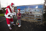 Redrow Homes<br /> <br /> Austin Davies age 7 with Father Christmas during his visit to Mon Bank Development.<br /> <br /> 22.11.14<br /> &copy;Steve Pope -FOTOWALES