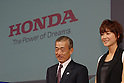 Honda Motor President Takeo Fukui and actress Juri Ueno, 22, pose with the new Life compact car. Ueno appears in its TV commercials. The standard models will be released on Friday and special mobility-assist model for handicapped users on Dec 5. The price range will be 945,000 yen to 1,680,000 yen..