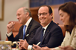 AUSTRALIA, Canberra : French President Francois Hollande smiles during a ministerial meeting with Australian Prime Minister Tony Abbott in the Cabinet room of Parliament House, Canberra on November 19, 2014. Hollande is on a two-day state visit to Australia following the G20 Summit over the weekend. AFP PHOTO / MARK GRAHAM (POOL)