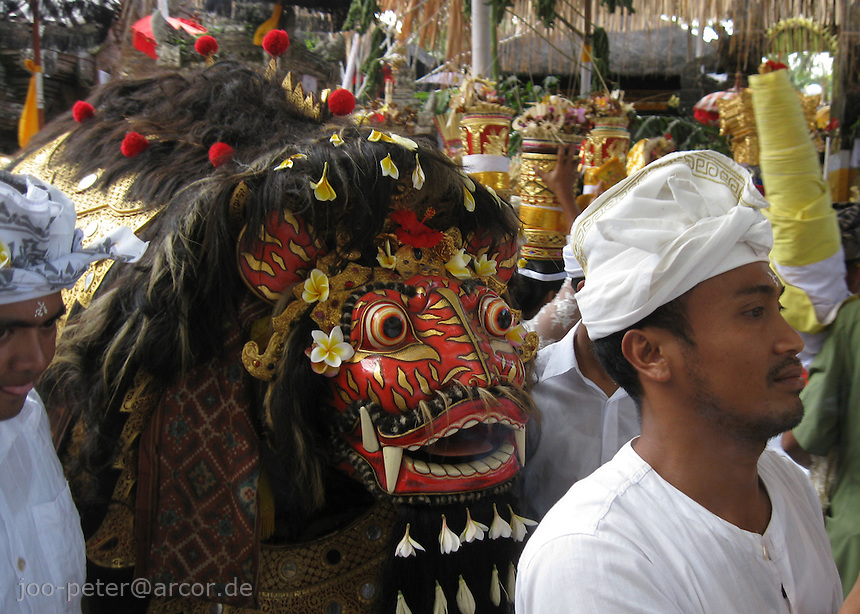 ceremonies in a temple north of Ubud, Bali, archipelago Indonesia. The mask of an incarnation of the devine spirit Barong is taken out for ritual procession.