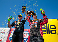 Jul 28, 2019; Sonoma, CA, USA; NHRA pro stock motorcycle rider Andrew Hines (left) and pro stock driver Greg Anderson celebrate after winning the Sonoma Nationals at Sonoma Raceway. Mandatory Credit: Mark J. Rebilas-USA TODAY Sports
