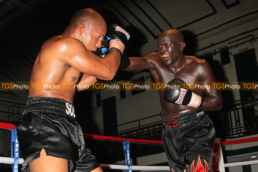 Leon Williams (black/white shorts) defeats Nick Okoth in a Cruiserweight boxing contest at York Hall, Bethnal Green, promoted by Miranda Carter/Left Jab Promotions - 18/09/11 - MANDATORY CREDIT: Gavin Ellis/TGSPHOTO - Self billing applies where appropriate - 0845 094 6026 - contact@tgsphoto.co.uk - NO UNPAID USE.