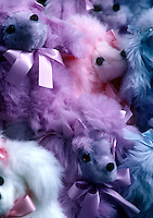 Close-up group of stuffed purple stuffed poodles from fair