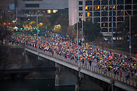 Thousands of Austin Marathon runners take over Congress Avenue Bridge after the start of the race during the annual Austin Marathon, held every February in downtown Austin, Texas.<br /><br />The Austin Marathon annually hosts runners from all 50 states and more than 20 countries around the world.