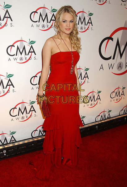 CARRIE UNDERWOOD.The 39th Annual CMA Country Music Awards held at Madison Square Garden, New York, NY .November 15th, 2005.Photo by: Laura Farr/AdMedia/Capital Pictures.Ref: LF/ADM.full length red dress layers ruffles.www.capitalpictures.com.sales@capitalpictures.com.© Capital Pictures.