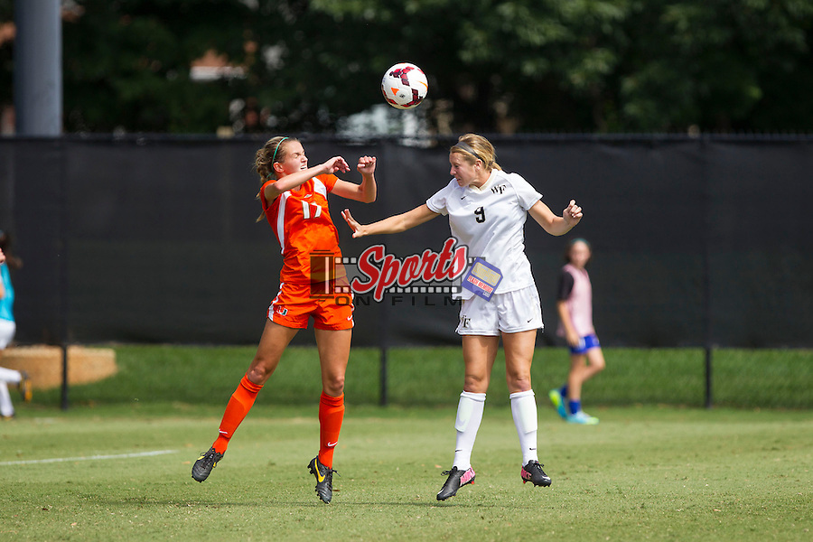 Jessica Mandarich (9) of the Wake Forest Demon Deacons battles for a jump ball with Gracie Lachowecki (17) of the Miami Hurricanes at Spry Soccer Stadium on September 15, 2013 in Winston-Salem, North Carolina.  The Deacons defeated the Hurricanes 4-0.   (Brian Westerholt/Sports On Film)