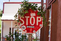 Stop sign covered w/ vine & decals in Haleiwa, Oahu, HI