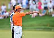 Bethesda, MD - July 2, 2017: Rickie Fowler talks over his missed putt with his caddy on the seventeenth hole during final round of professional play at the Quicken Loans National Tournament at TPC Potomac at Avenel Farm in Bethesda, MD.  (Photo by Phillip Peters/Media Images International)