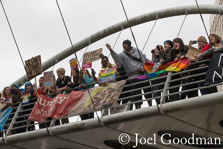 """© Joel Goodman - 07973 332324 . 11/06/2017 . Manchester , UK . Anti fascists jeer at the demonstration from a bridge . Demonstration against Islamic hate , organised by former EDL leader Tommy Robinson's """" UK Against Hate """" and opposed by a counter demonstration of anti-fascist groups . UK Against Hate say their silent march from Piccadilly Train Station to a rally in Piccadilly Gardens in central Manchester is in response to a terrorist attack at an Ariana Grande concert in Manchester , and is on the anniversary of the gun massacre at the Pulse nightclub in Orlando . Photo credit : Joel Goodman"""