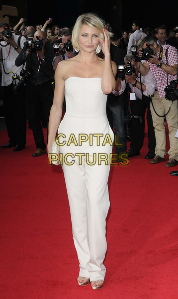 Cameron Diaz.The 'What To Expect When You're Expecting' UK film premiere, BFI Imax cinema, Charlie Chaplin Walk, London, England..May 22nd, 2012.full length white top strapless trousers hand arm clutch bag jumpsuit.CAP/CAN.©Can Nguyen/Capital Pictures.