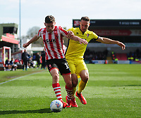 Lincoln City's Shay McCartan battles with  Cheltenham Town's Chris Hussey<br /> <br /> Photographer Andrew Vaughan/CameraSport<br /> <br /> The EFL Sky Bet League Two - Lincoln City v Cheltenham Town - Saturday 13th April 2019 - Sincil Bank - Lincoln<br /> <br /> World Copyright &copy; 2019 CameraSport. All rights reserved. 43 Linden Ave. Countesthorpe. Leicester. England. LE8 5PG - Tel: +44 (0) 116 277 4147 - admin@camerasport.com - www.camerasport.com