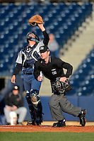 Umpire Jeff Morrow gets into position as catcher J.R. Murphy looks for the ball during a game between the Akron Aeros and Trenton Thunder on April 22, 2013 at Canal Park in Akron, Ohio.  Trenton defeated Akron 13-8.  (Mike Janes/Four Seam Images)