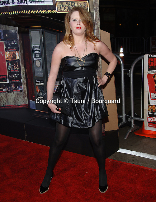 Natasha Lyon  arriving at the Grindhouse Premiere at the Orpheum Theatre In Los Angeles.<br /> <br /> full length<br /> eye contact<br /> full length<br /> black dress