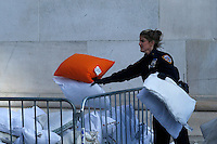 A NYPD officer collects pillows as people take part in the pillow fight at Washington Square in New York. 04.04.2015. Eduardo MunozAlvarez/VIEWpress.