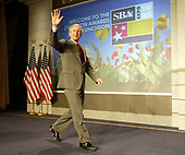 United States President George W. Bush waves as he arrives to make remarks at the Small Business Administration's National Small Business Week Conference at the Washington Hilton Hotel in Washington, DC on Wednesday, 27 April 2005.<br /> Credit: Matthew Cavanaugh / Pool via CNP