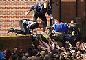 "17/02/15  <br /> <br /> Players reach for the ball at the annual Royal Shrovetide Football  Match in Ashbourne, Derbyshire. After 'turning up' the ball at 2pm thousands of rival Up'Ards' and Down'Ards' team members attempt to 'goal' the ball onto stones set three miles apart in the town of Ashbourne, Derbyshire. The game also known as ""hugball"" has been played from at least c.1667 although the exact origins of the game are unknown but one of the most popular origin theories suggests the macabre notion that the 'ball' was originally a severed head tossed into the waiting crowd following an execution.<br /> <br /> <br /> All Rights Reserved - F Stop Press.  www.fstoppress.com. Tel: +44 (0)1335 418629 +44(0)7765 242650"