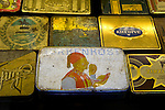 Antique cigarette boxes on display is storefront window in the Taksim district of Istanbul