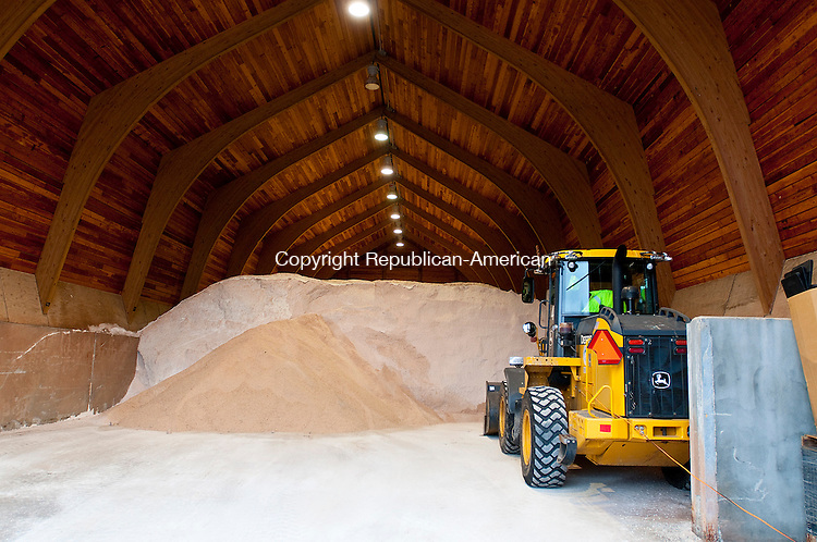 WATERBURY,  CT, 04 JANUARY  2012-010412JS01-A large pile of road salt sits inside a DOT building at their facility on Chase River Road in Waterbury on Wednesday. With the lack of snowfall, many towns are hoping for a surplus in their snow removal budget..Jim Shannon Republican-American