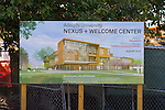 Garden City, New York, U.S. - August 29, 2014 - Adelphi University campus, sign for Nexus and Welcome Center building construction, in summer