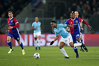 Manchester City's Raheem Sterling holds off the challenge from Basel's Serey Die <br /> <br /> Photographer Craig Mercer/CameraSport<br /> <br /> UEFA Champions League Round of 16 First Leg - Basel v Manchester City - Tuesday 13th February 2018 - St Jakob-Park - Basel<br />  <br /> World Copyright &copy; 2018 CameraSport. All rights reserved. 43 Linden Ave. Countesthorpe. Leicester. England. LE8 5PG - Tel: +44 (0) 116 277 4147 - admin@camerasport.com - www.camerasport.com