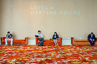 People sitting outside a meeting room at the Marina Bay Sands resort hotel. There are about 200 meeting rooms at the resort. It is one of the main engines attracting visitors to the resort, and eventually to the casino.