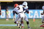 24 October 2015: Virginia's Quin Blanding (3) tackles UNC's Elijah Hood (behind). The University of North Carolina Tar Heels hosted the University of Virginia Cavaliers at Kenan Memorial Stadium in Chapel Hill, North Carolina in a 2015 NCAA Division I College Football game. UNC won the game 26-13.