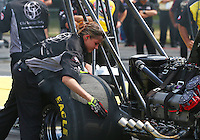 Aug. 2, 2014; Kent, WA, USA; Crew member Cassie Simonton for NHRA top fuel dragster driver Bob Vandergriff Jr during qualifying for the Northwest Nationals at Pacific Raceways. Mandatory Credit: Mark J. Rebilas-