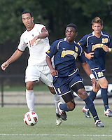 Quinnipiac University midfielder Willya Mekolo (9) brings the ball forward. Boston College defeated Quinnipiac, 5-0, at Newton Soccer Field, September 1, 2011.
