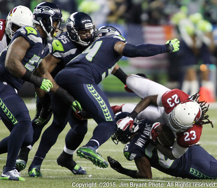 Seattle Seahawks  cornerback Cary Williams (26) upends Arizona Cardinals  running back Chris Johnson at CenturyLink Field in Seattle, Washington on November 15, 2015. The Cardinals beat the Seahawks 39-32.   ©2015. Jim Bryant photo. All Rights Reserved.