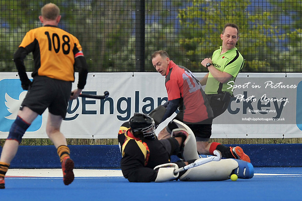 KIMBER Colin (GK, Bournemouth) saves from GORSE Karl (Bowdon). Bournemouth v Bowdon (Men's Over 50's Shield Final). Pitch 2. Men's Knockout Finals 2017. Lee Valley Hockey and Tennis Centre. London. UK. 29/04/2017. ~ MANDATORY CREDIT Garry Bowden/SIPPA - NO UNAUTHORISED USE - +44 7837 394578
