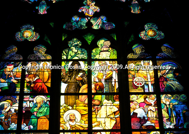 Stainglass window by Mucha in the St. Vitus Cathedral at the Prague Castle at in Prague, Czech Republic.