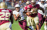 Louisiana Monroe quarterback Caleb Tucker cuts between Florida State defensive back Nate Andrews ((29) and defensive tackle Demarcus Christmas (90) in the 2nd half of an NCAA college football game in Tallahassee, Fla., Saturday, Dec. 2, 2017. Florida State defeated Louisiana Monroe  (AP Photo/Mark Wallheiser)